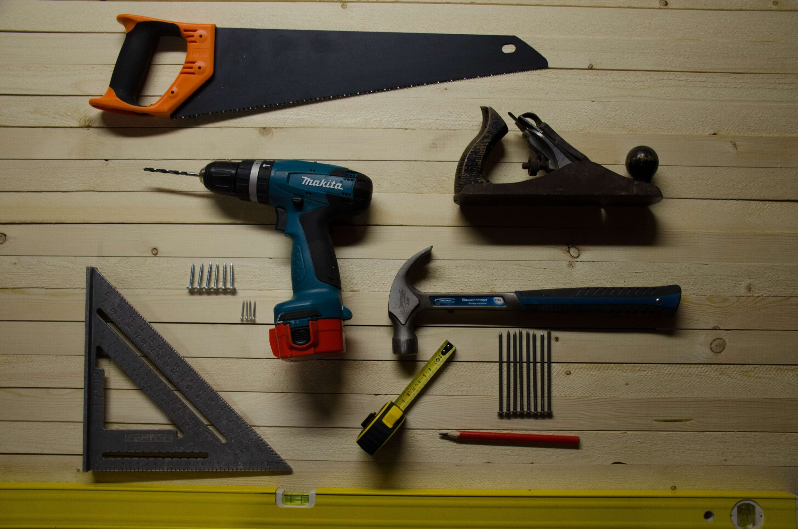A set of builder tools neatly placed on a table